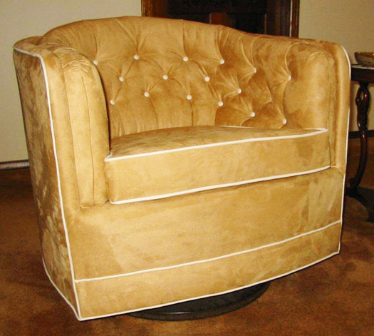 angled view of upholstered chair that coordinates with couch