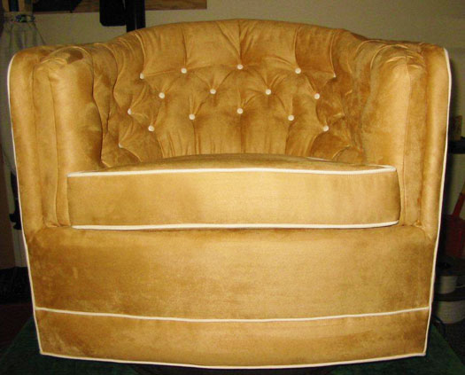 reupholstered swivel rocker coordinated to match couch