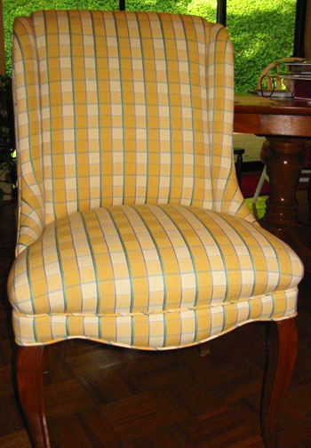 new fabric on an old chair breeds new life